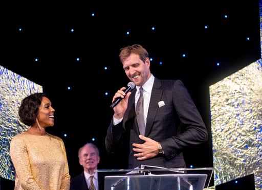 Jessica and Dirk Nowitzki accept award.jpg