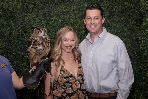 Holly and Matt Quartaro with an Eurasian eagle owl